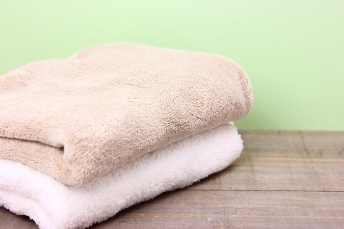 蒸しタオルで筋肉を温める
